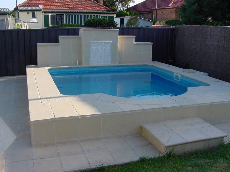 Courtyard swimming pools ideal for townhouses small areas for Local pool builders
