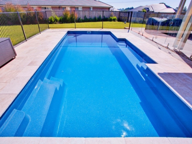 Beautiful contemporary swimming pool design the vogue for Local pool builders